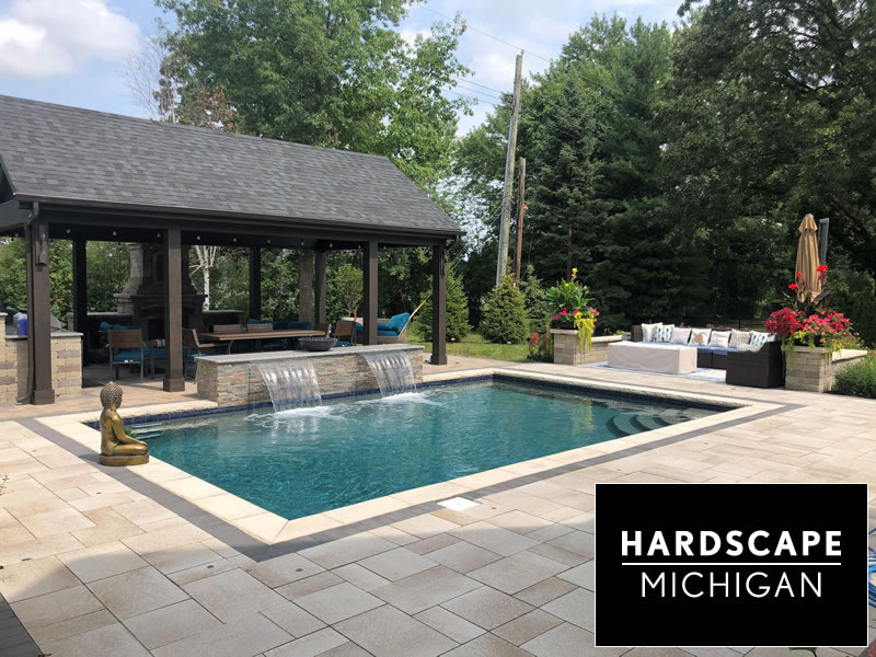 Custom Gunite Pool / Paver Sundeck and Raised Fountain Wall  Installation. With Cedar Pavilion  and Stone Fireplace. Troy, MI